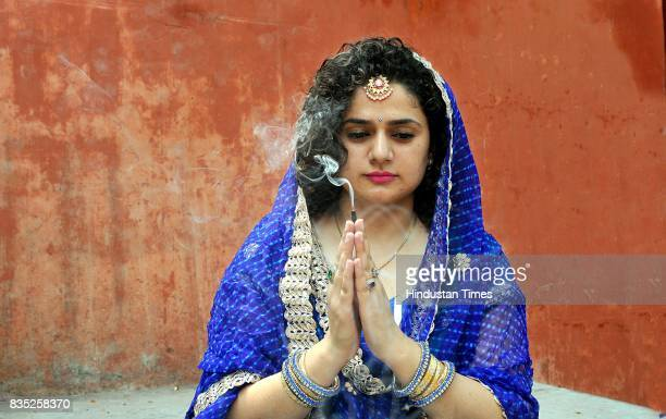 Women belonging to the Dogra community praying for the long life of their sons during the 'Bacch Dua' festival on August 18 2017 in Jammu India