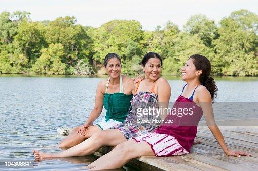 Women beside a lake