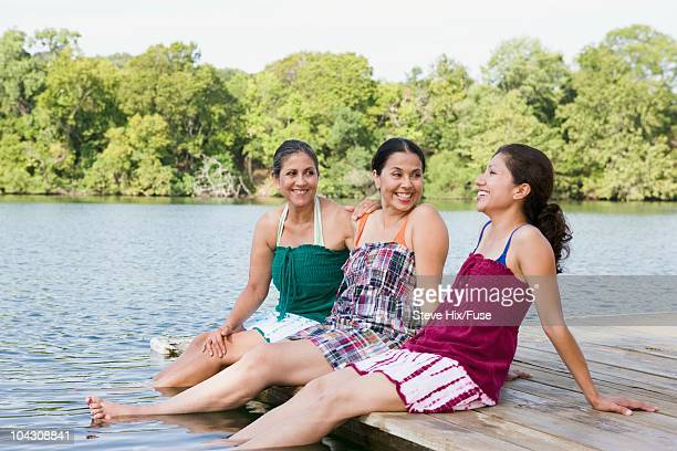 Women beside a lake