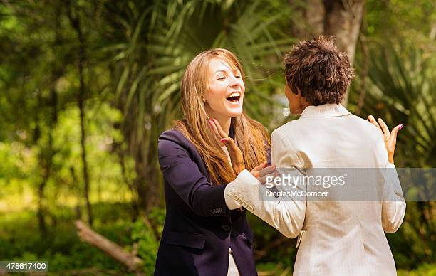 Women best friends office workers ecstatic over good news