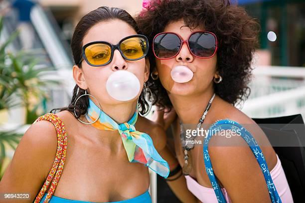 Women blowing bubble Gum