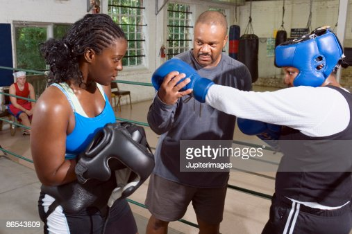 Women boxers with coach : Stock Photo