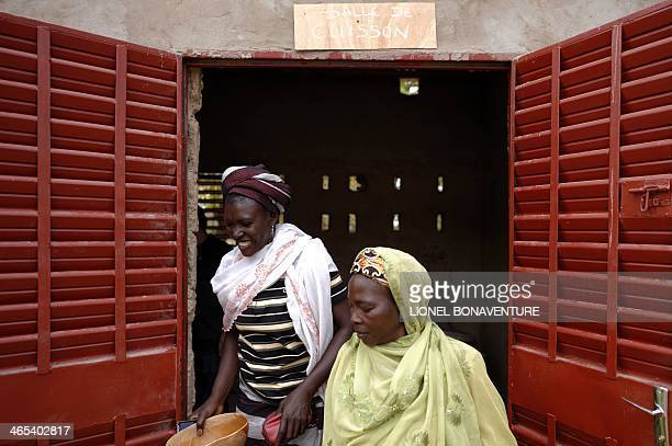 Women brew a local beer called 'Dolo' on January 24 2014 thanks to a microcredit program funded by the French cosmetics company L'Occitane in Leo...