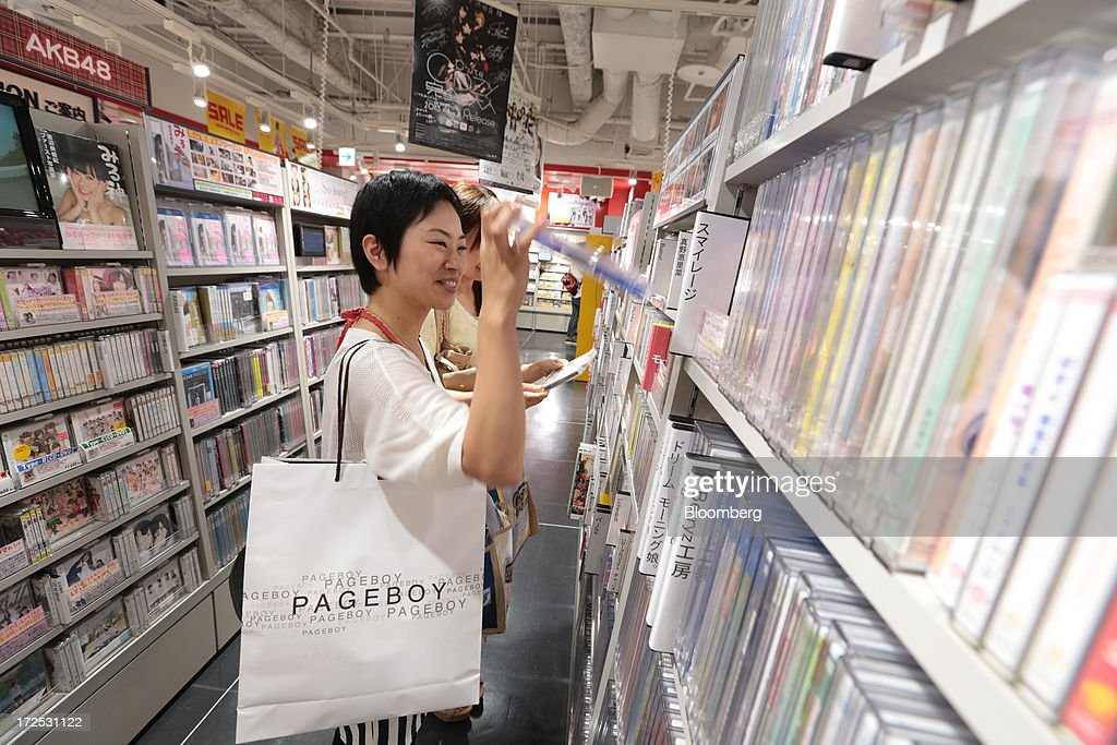 Women browse Japanese pop music (J-Pop) CDs at a Tower Records Japan Inc. store in Tokyo, Japan, on Monday, July 1, 2013. Music sales in the country rose for the first time in five years, led by tunes delivered on CDs and other physical media, bucking the trend in developed markets as cheaper downloads gain ground. Physical media made up 82 percent of Japanese music sales last year, versus 37 percent in the U.S., said the Recording Industry Association of Japan. Photographer: Yuriko Nakao/Bloomberg via Getty Images