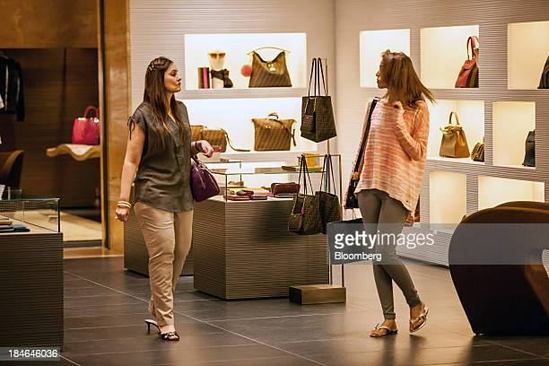 Women browse merchandise inside a Fendi store a brand of LVMH Moet Hennessy Louis Vuitton SA at the DLF Emporio shopping mall in New Delhi India on...