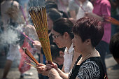Women burning incense and praying at the gates of the Lama Temple in Beijing China The Lama Temple Beijing or Palace of Peace and Harmony Lama Temple...