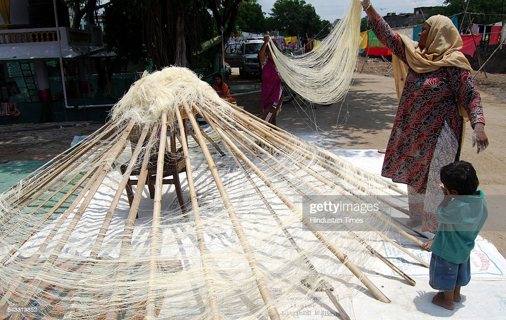 Women busy in making of vermicelli, popularly known as Semiya ahead of Eid on June 27, 2016 in Indore, India. Semiya is used in the preparation of Sheerkurma, a traditional sweet dish prepared by Muslims during the holy month of Ramzan