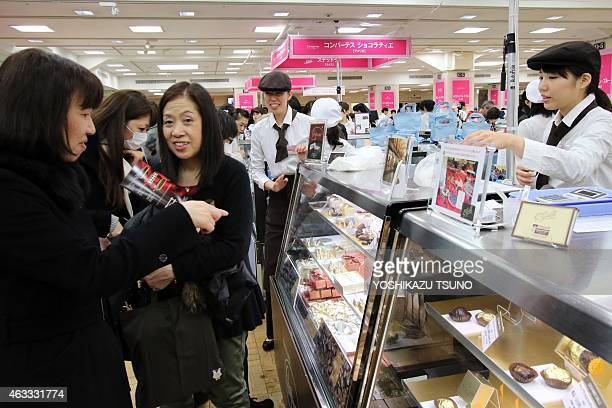 Women buy boxes of chocolates as gifts before Valentine's Day at Tokyo's Mitsukoshi department store on February 13 2015 Japanese women jostled...
