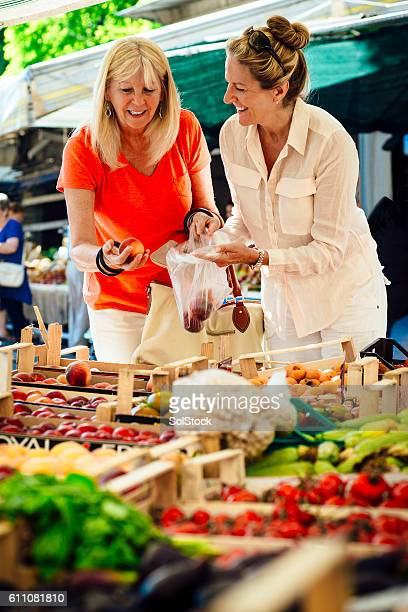 Women Buying Fruit from a Market Stall