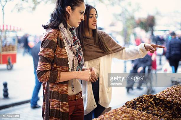 Women Buying Nuts at Bazaar