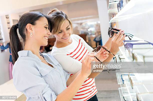 Women buying sunglasses at the optician's shop