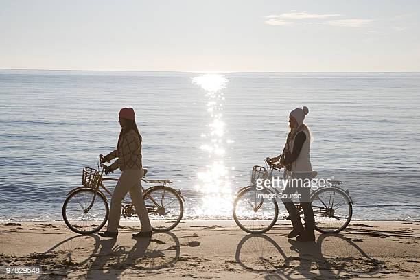 Women by the sea with bicycles