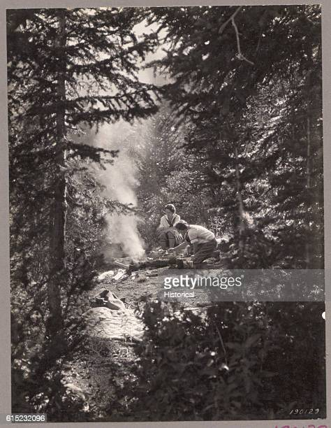 Women camping in the Wasatch National Forest sit around a campfire Utah 1924 | Location head of Big Cottonwood Canyon Wasatch National Forest Utah USA