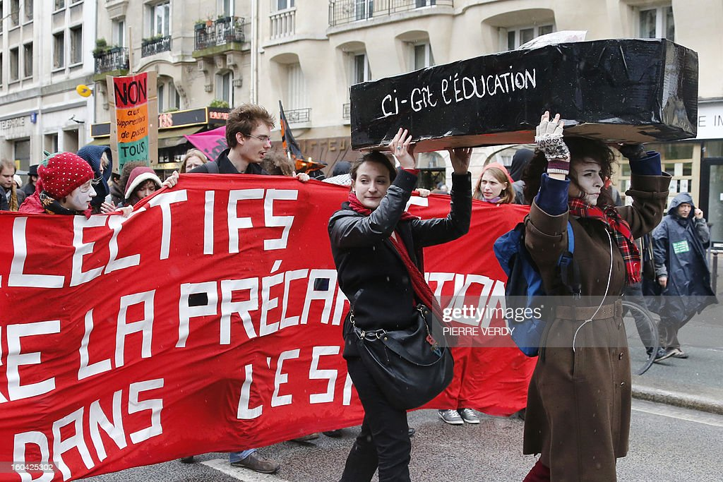 Women carry a coffin as members of the public sector, (education, health and finance) take part on January 31, 2013 in a national day of protest in Paris against the French government's social policy. For the first time since French President Francois Hollande's election, three labour unions (CGT, FSU, Solidaires) called on 5.2 million civil servants to stop working to show to the government their unhappiness, particularly in terms of purchasing power.