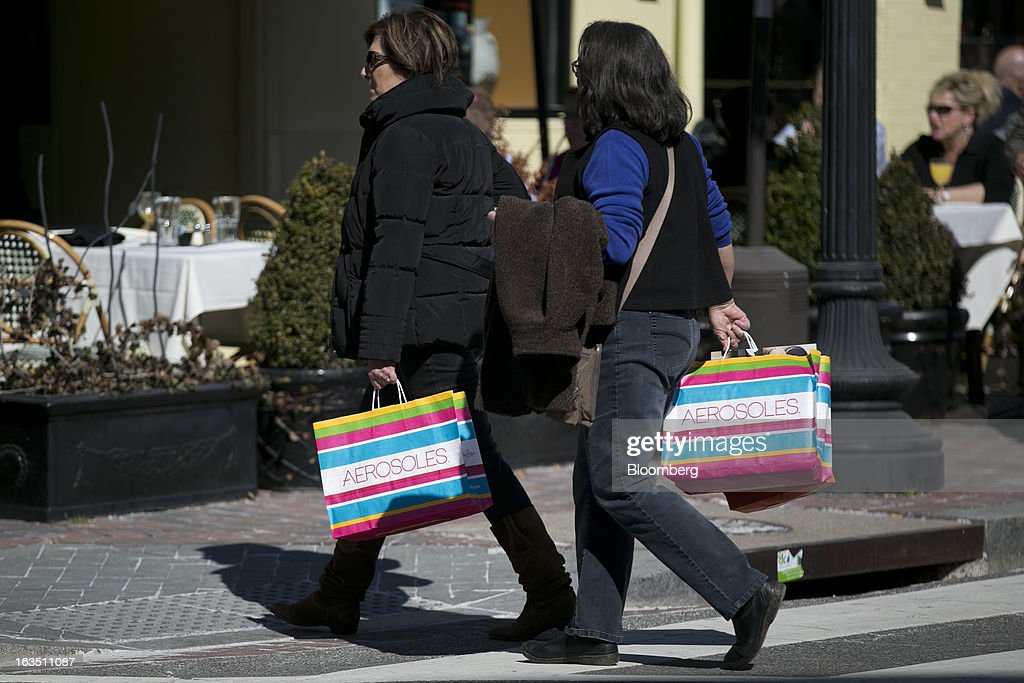 Women carry Aerosoles shopping bags in the Georgetown neighborhood of Washington, D.C., U.S., on Saturday, March 9, 2013. The U.S. Census Bureau is expected to release advance retail sales data for February on March 13. Photographer: Andrew Harrer/Bloomberg via Getty Images