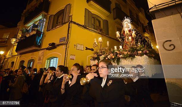 Women carry an effigy of Jesus Christ on the cross down steps during the 'Cristo de la Fe ' populary known as the gypsy Christ parade during a Holy...