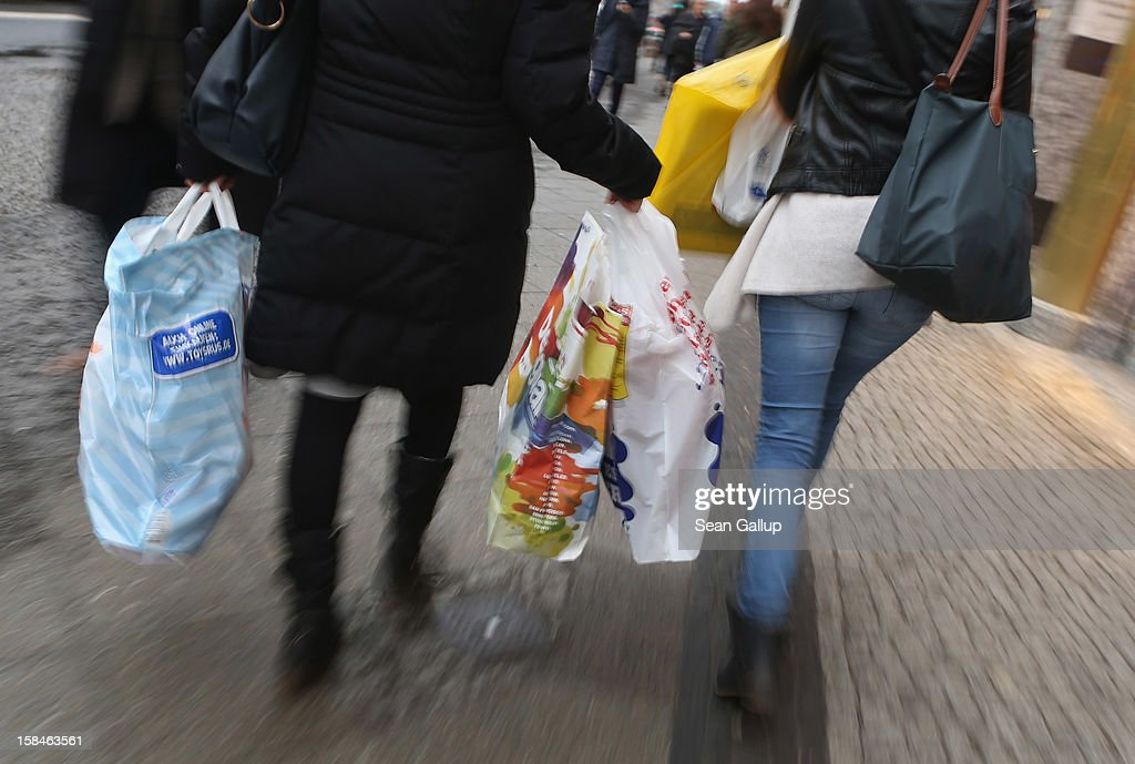 Women carry shopping bags on a shopping street in Steglitz district on December 17, 2012 in Berlin, Germany. Retailers are hoping for a strong Christmas season in Germany, one of the few countries whose economy has so far weathered the current Eurozone debt crisis relatively well.