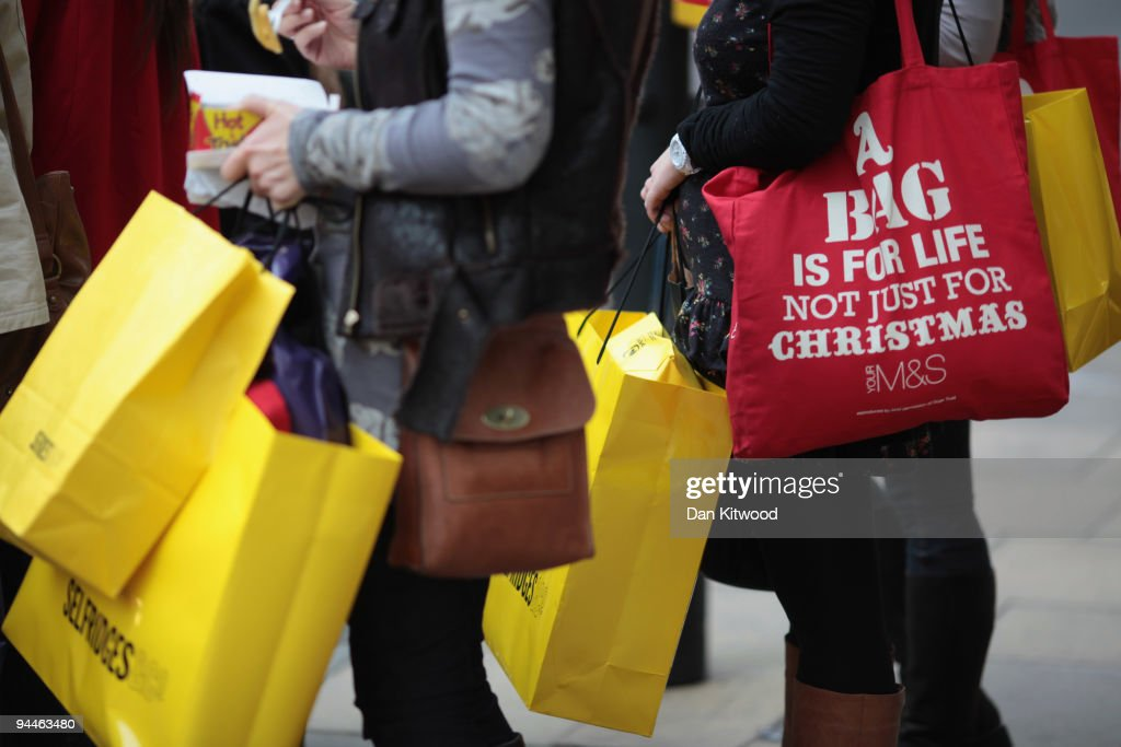 Women carry shopping bags on New Bond Street on December 14, 2009 in London, England. High street stores are expecting a bumper Christmas this year despite the economic dowturn, with shoppers spending around GBP £120 million in the past two days alone.