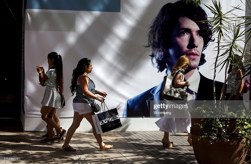 Women carry shopping bags while walking through the Fashion Valley Mall in San Diego, California, U.S., on Saturday, June 22, 2013. The Bureau of Economic Analysis is schedule to release personal consumption figures on June 26. Photographer: Sam Hodgson/Bloomberg via Getty Images
