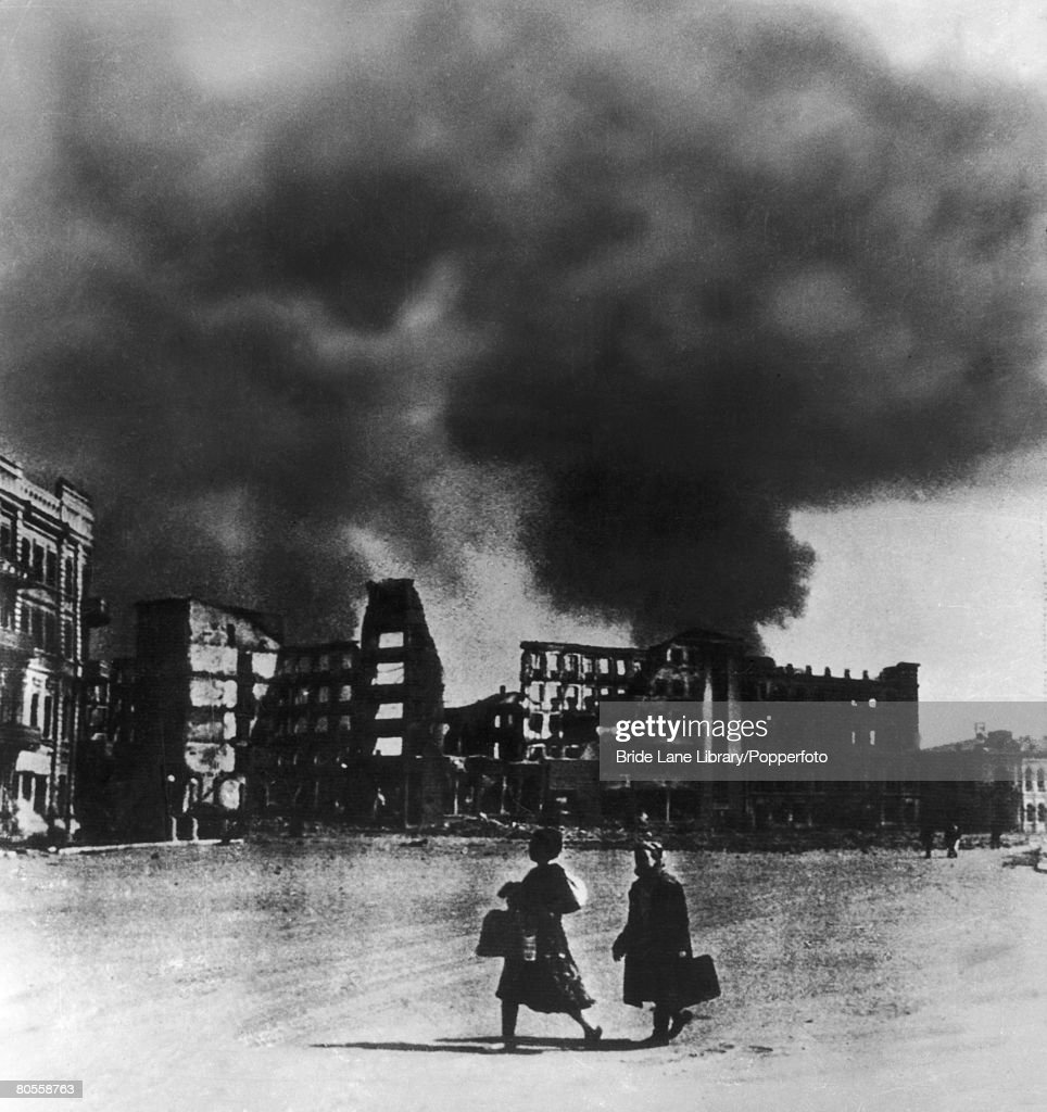 Women carry supplies to the defenders as smoke rises over the city during the Battle of Stalingrad October 1942
