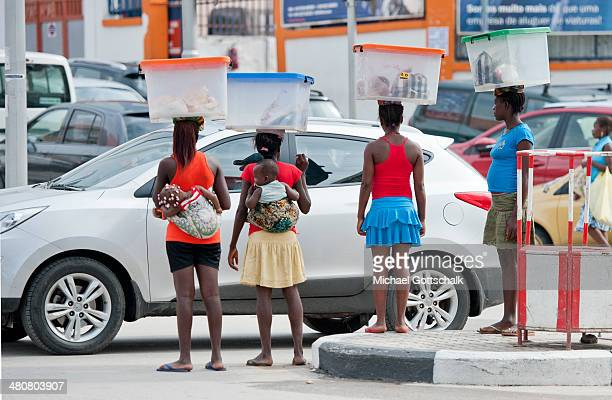 Women carry their babies and transport goods in boxes on their heads on March 26 2014 in Luanda Angola