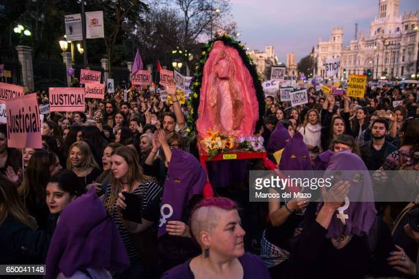 Women carrying in procession a giant vagina during a demonstration for International Woman's Day