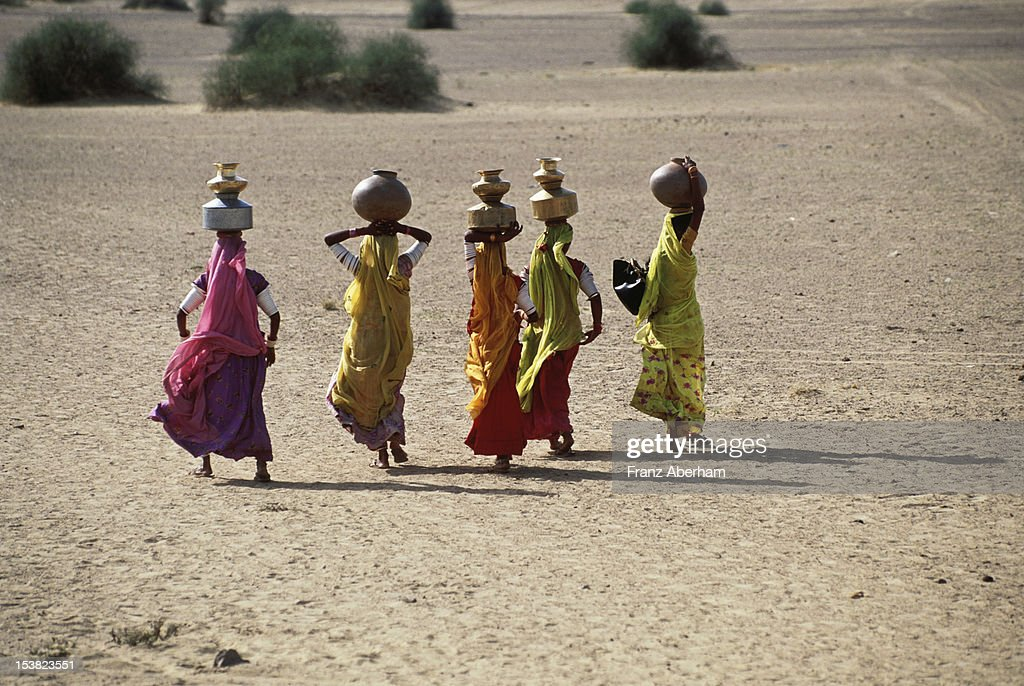 Women carrying water, India