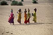 Women carrying water, India