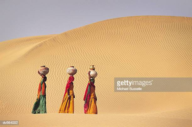 Women carrying water, Jaiselmer, India
