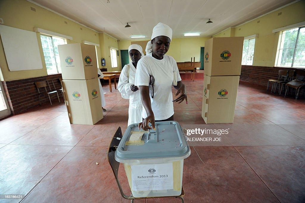 Women cast their vote at a polling station in Chitungwiza, on March 16, 2013, for a key referendum on a new constitution that would curb President's powers and pave the way for elections later in the year.