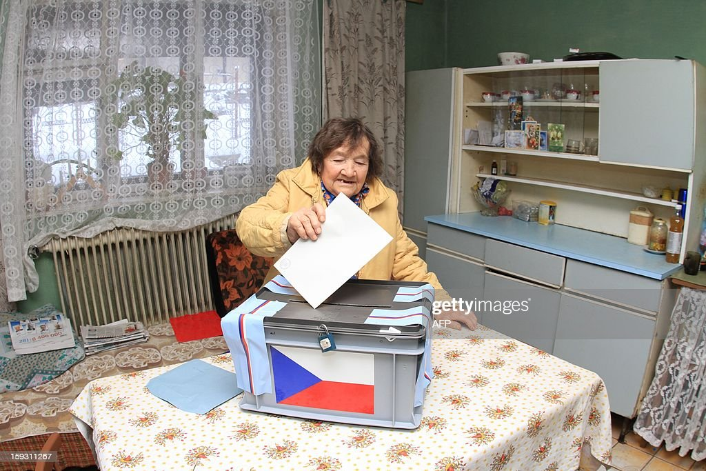 A women casts her ballot in Lopenik, Czech, on January 11, 2013. Members of the electoral commission visit people living in remote to take part in the first Czech direct presidential election. Czech polling stations opened on January 11 afternoon in local mid-time for the first round of the first Czech direct presidential election in history.