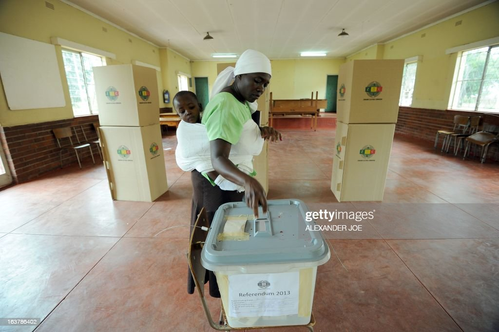 A women casts her vote at a polling station in Chitungwiza, on March 16, 2013, as voting kicked off for Zimbabwean referendum for a new constitution designed to underpin democratic reforms.