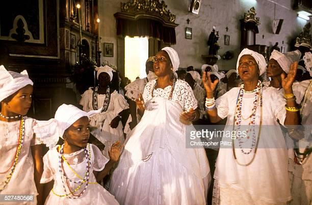 Women celebrate the patron saint of the ' Baiana do Acaraje' in Pelorinho's church of Nossa Senhora dos Rosarios dos Pretos Salvador de Bahia Brazil