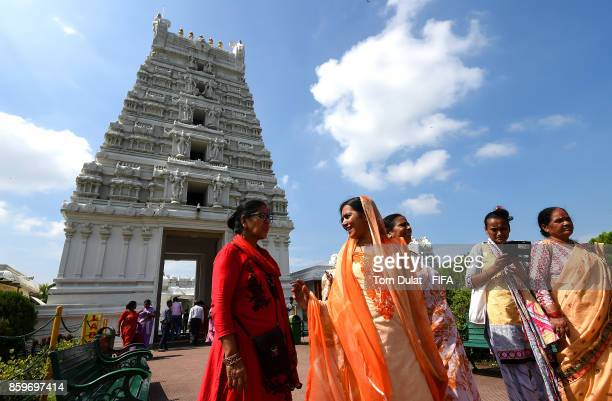 Women chat in front of Tirupati Sri Balaji Temple during the FIFA U17 World Cup India 2017 tournament on October 10 2017 in Guwahati India