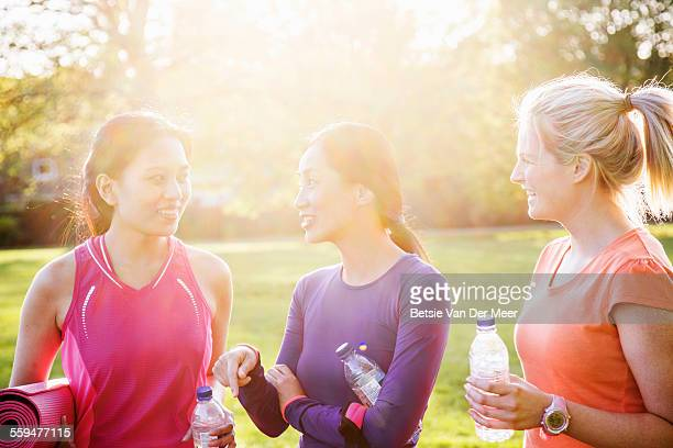 Women chatting after exercising in park
