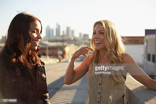 Women chatting on bridge