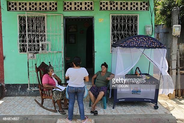 Women chatting on the porch of a house in Managua on April 14 keep a cot with them as a precaution for tremors have not stopped in Nicaragua since...