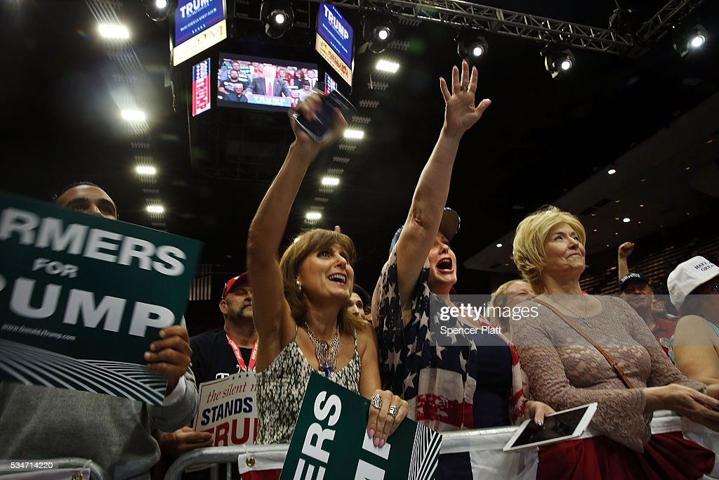 Women cheer as presumptive Republican presidential candidate Donald Trump speaks at a rally in Fresno on May 27, 2016 in Fresno, California. Trump is on a Western campaign trip which saw stops in North Dakota and Montana yesterday and two more in California today.