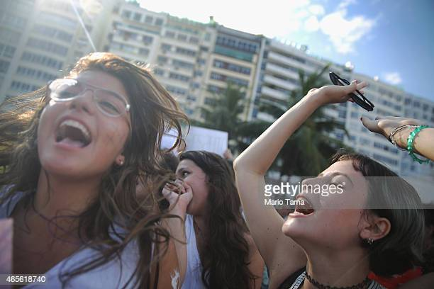 Women cheer during a march marking International Women's Day on March 8 2015 in Rio de Janeiro Brazil Marches and events were held worldwide to...