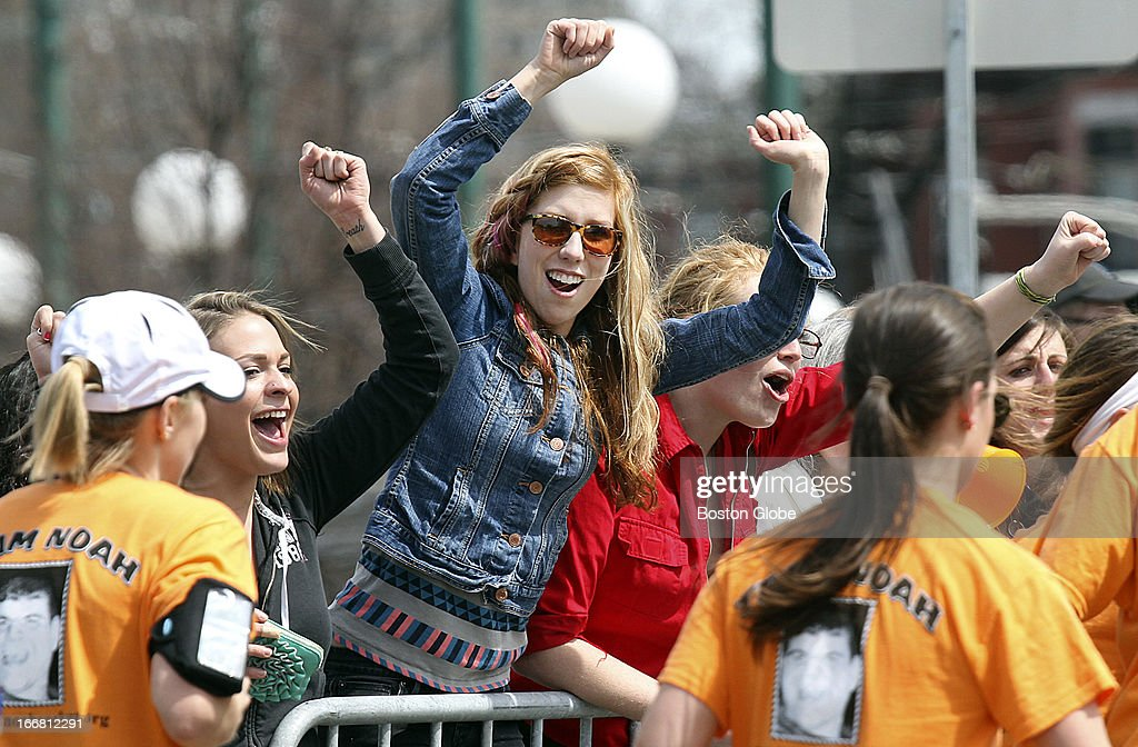 Women cheer on runners at Cleveland Circle during the 117th Boston Marathon.