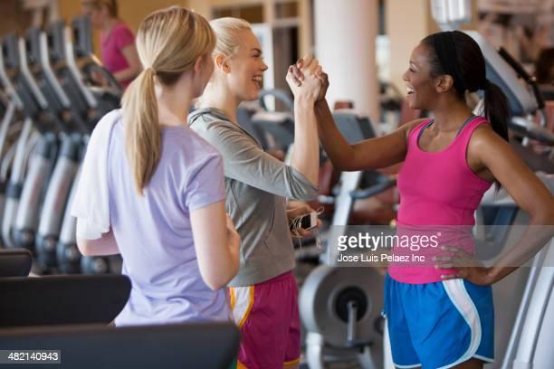 Women cheering in gym
