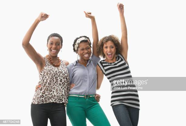 Women cheering together