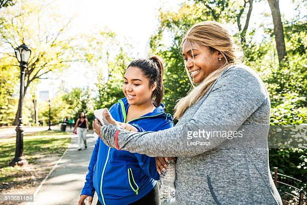 Women chilling out post workout in Central Park New York