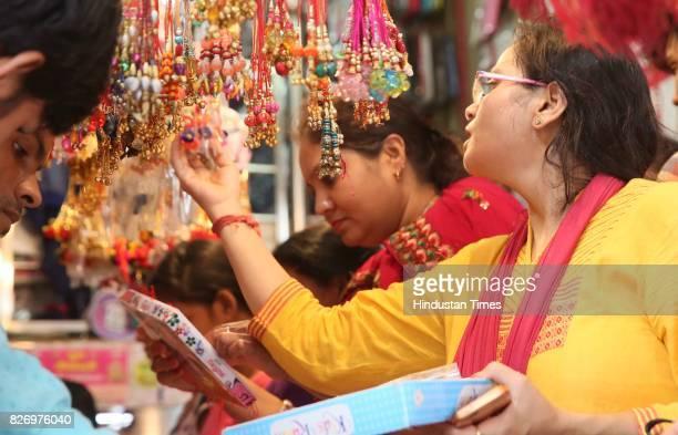 Women choose Rakhi for their brothers on the eve of Raksha Bandhan Festival on August 6 2017 in Jaipur India Raksha Bandhan or simply Rakhi is a...