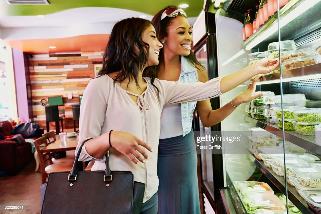 Women choosing deli food in cafe