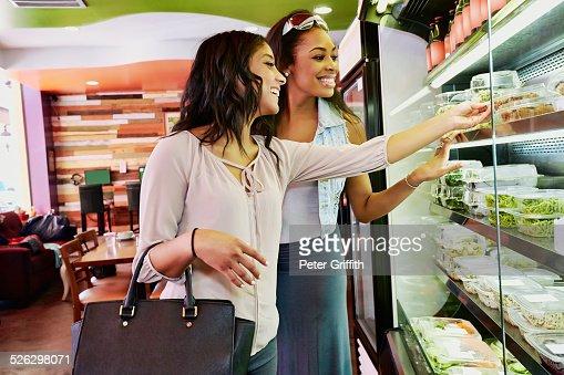 Women choosing deli food in cafe