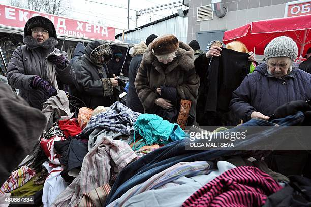 Women chose clothes at a street second hand market in St Petersburg on December 28 2014 Deep recession skyrocketing prices and a fragile banking...
