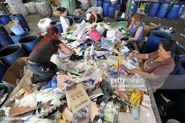 Women classify recyclable garbage at La Alqueria Recycling Center in Bogota Colombia on January 17 2013 Some 60 recyclers classify 10 tons daily of...