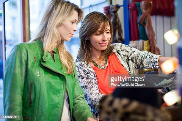 Women clothes shopping together