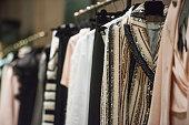 Women clothing on hangers in a store in Milan